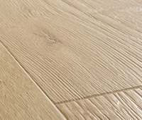Laminate flooring with genuine bevels