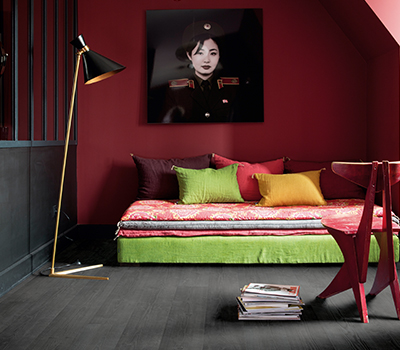 black laminate flooring in a cosy bedroom